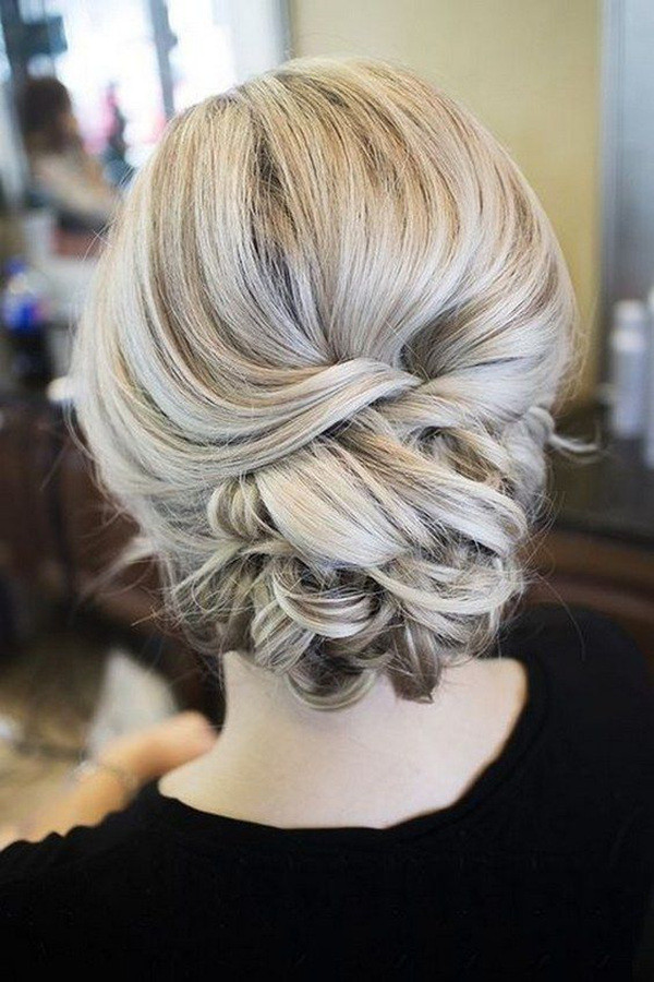 20 most romantic bridal updos wedding hairstyles to inspire your elegant updo wedding hairstyles junglespirit Images