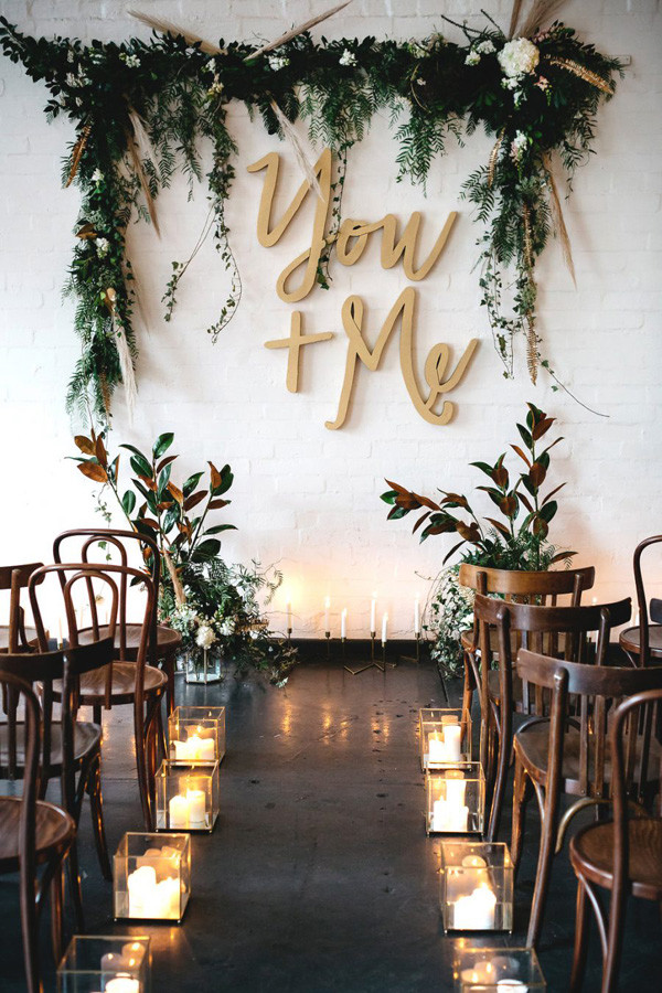 amazing metallic wedding ceremony ideas with candle aisle