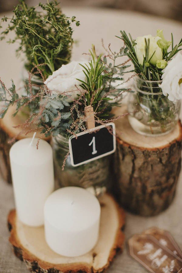 wedding centerpiece ideas with tree stumps for forest weddings