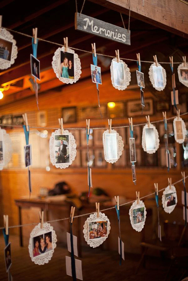 hanging photo display with lace papers for country wedding ideas