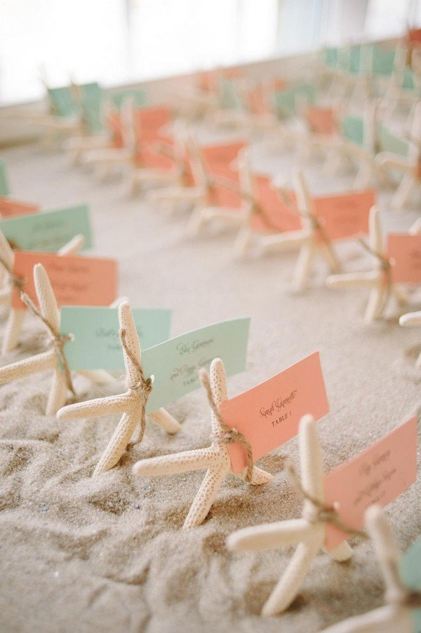 mint and coral beach themed wedding escort cards with starfish