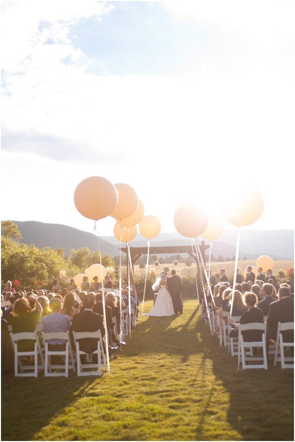 romantic outdoor wedding ceremony ideas with balloon aisles