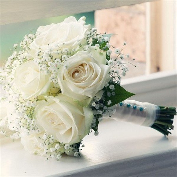 rose and baby's breath wedding bouquet with greenery