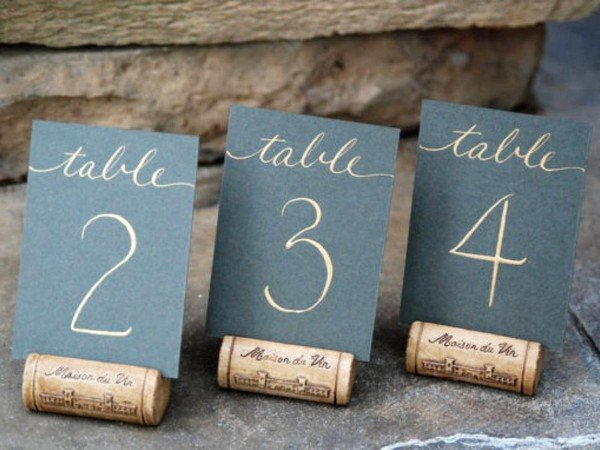calligraphy wedding table number ideas with wine cork stands