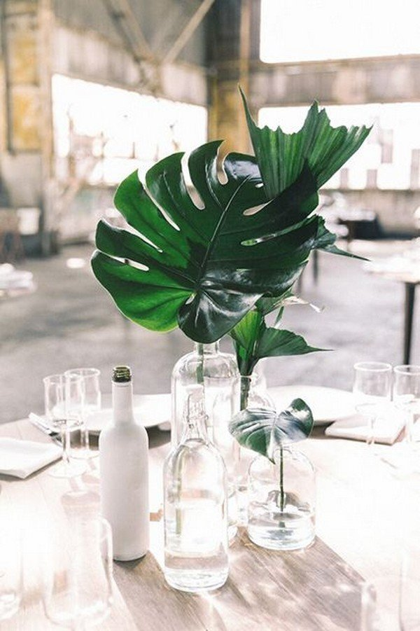 Candle centerpiece decorated with eucalyptus