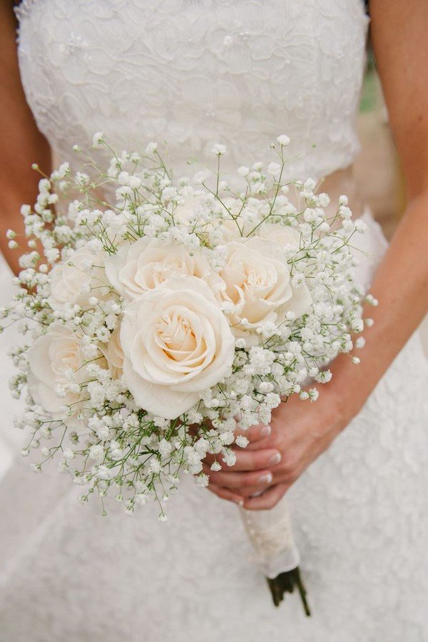 ivory roses and baby's breath wedding bouquet