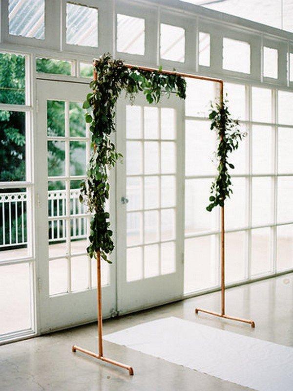 greenery wedding backdrop with copper frame