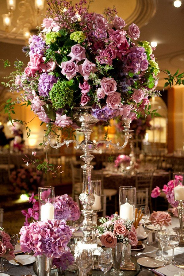 stunning flowers wedding centerpieces with candlstick stands