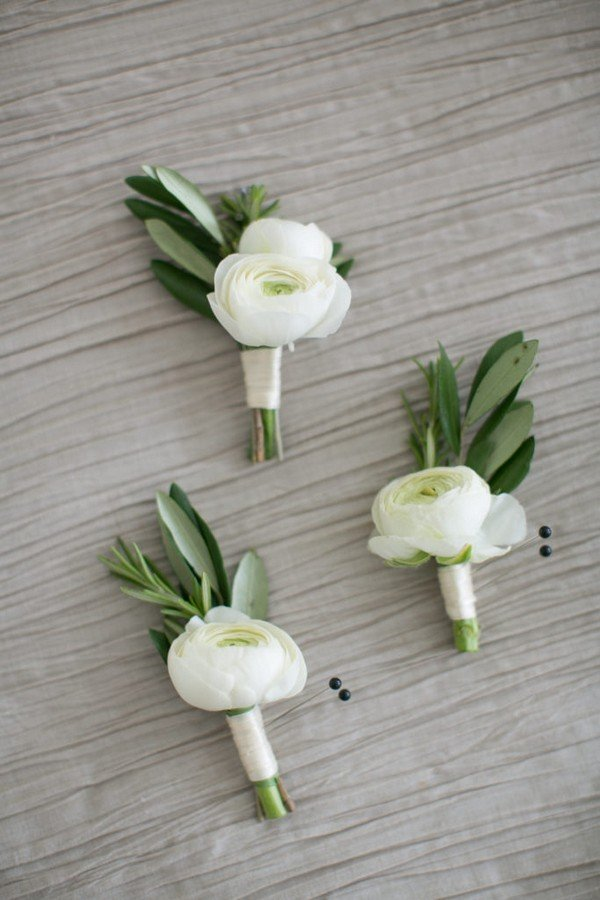 white and greenery groomsmen boutonnieres