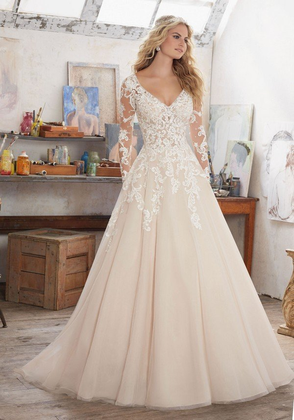 Morilee blush wedding dress with long lace sleeves