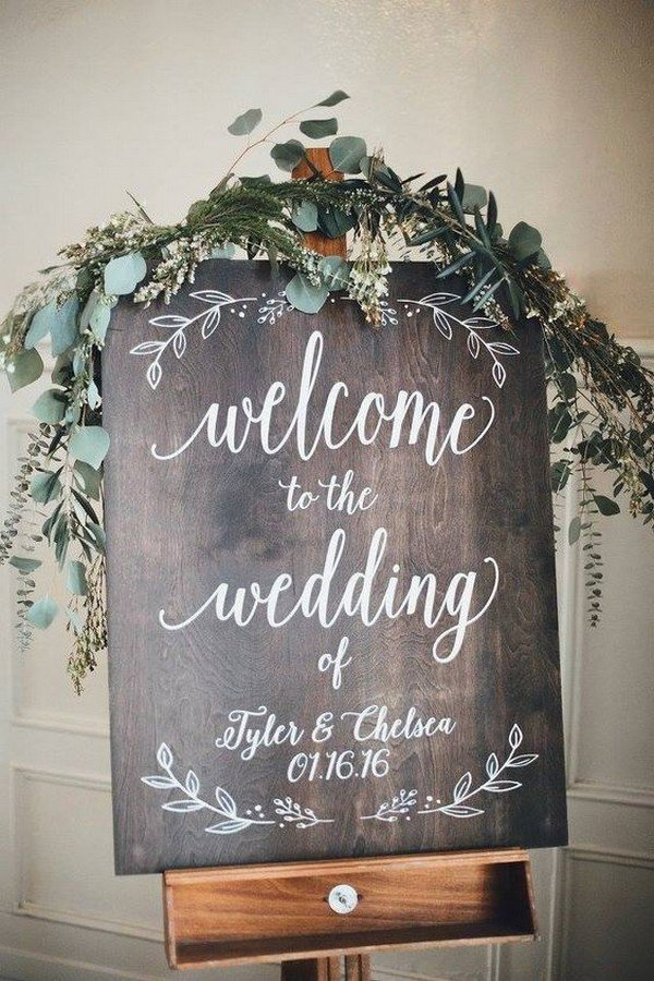 chic greenery decorated wooden wedding sign