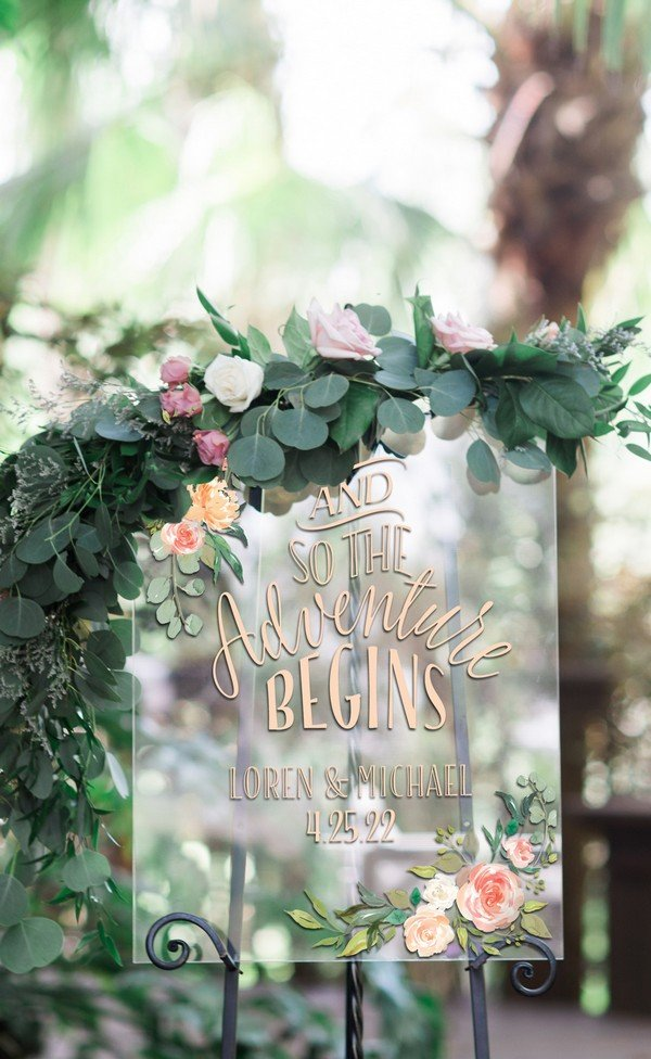 clear glass wedding sign with gold calligraphy