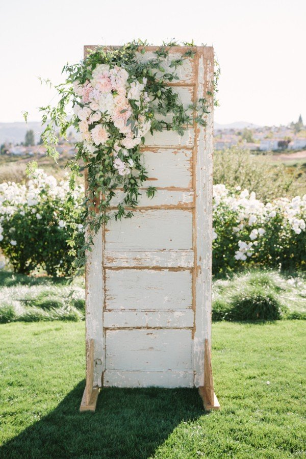 greenery outdoor wedding decoration ideas with old door
