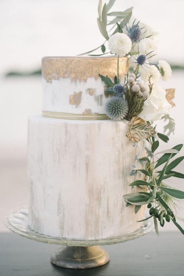 metallic gold wedding cake with greenery