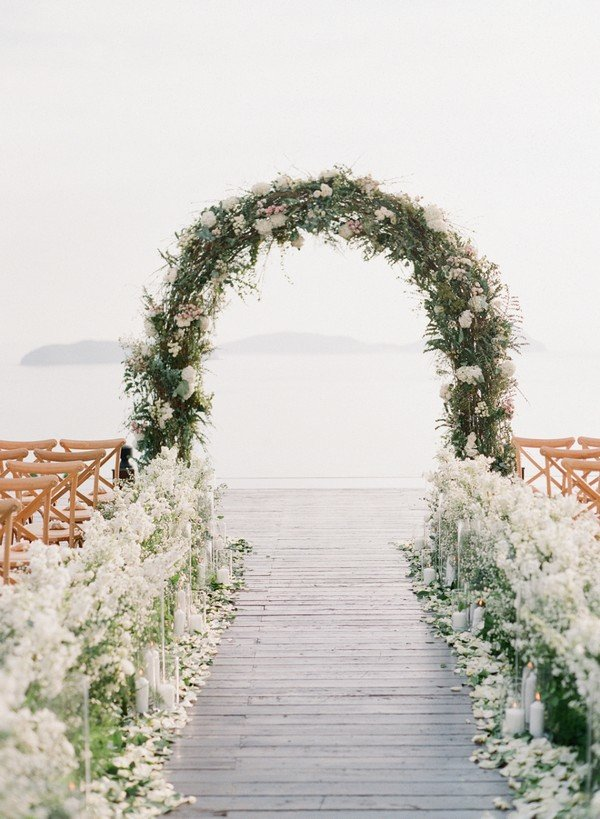 lakeside wedding ceremony decorations with floral arch