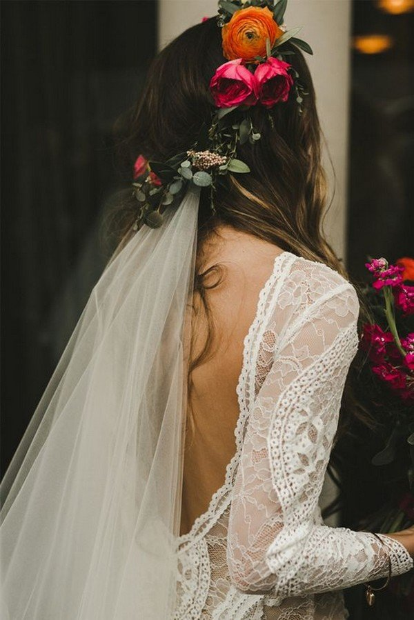 wedding hairstyle with flower crown and veil