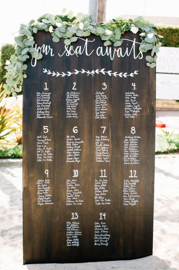 chic wooden wedding seating chart ideas with greenery decorations