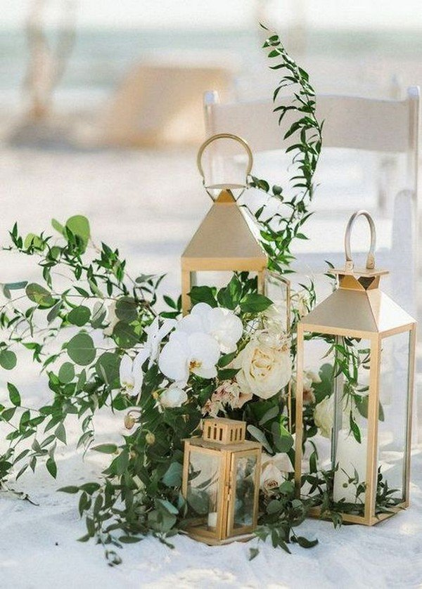 gold lantern wedding aisle decoration ideas with greenery