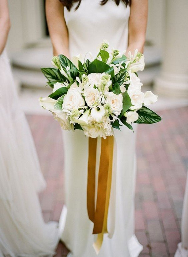 white and green wedding bouquet with gold ribbon