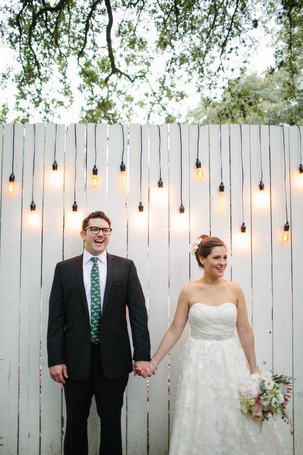 wooden wedding photobooth backdrop with string lights