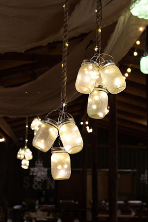 rustic mason jar lights hung from the ceiling for barn wedding ideas