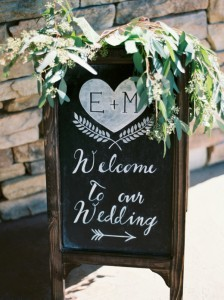 chic chalkboard wedding welcome sign with green floral decoration