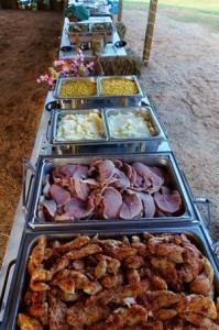 Country buffet for a wedding reception under an open barn wedding ideas