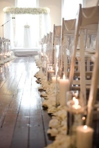 romantic all white weddings with candle and flower aisles