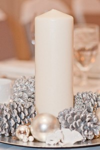winter wedding centerpiece inspired by candles and pinecones