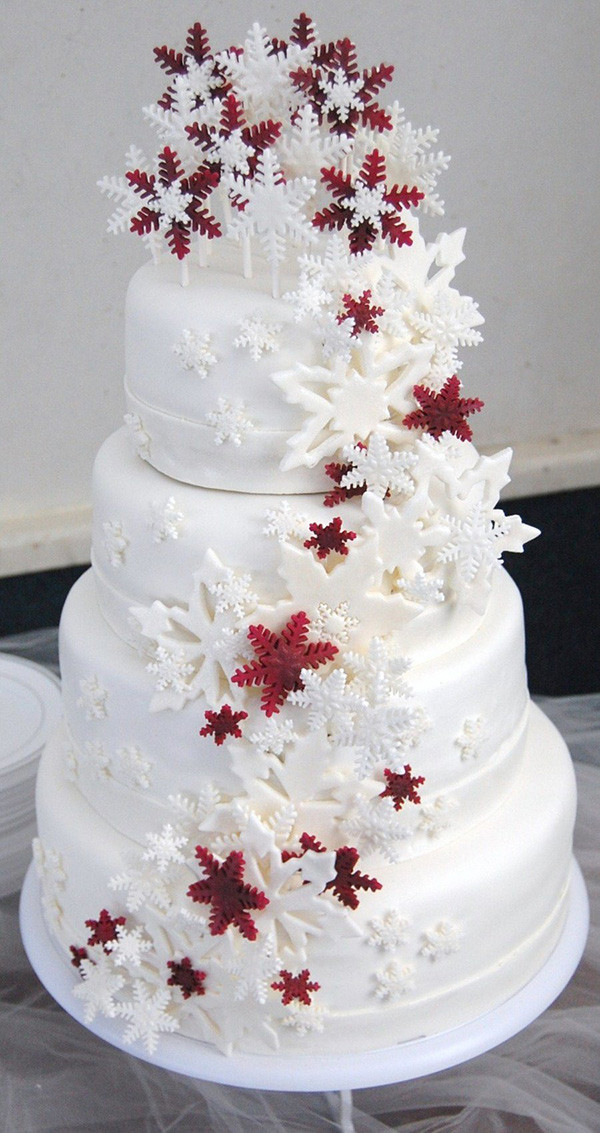 white and red snowflake christmas inspired wedding cakes