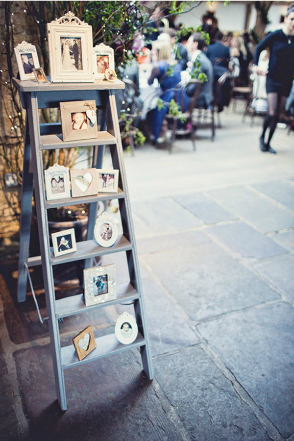 photo display with ladder for vintage wedding ideas