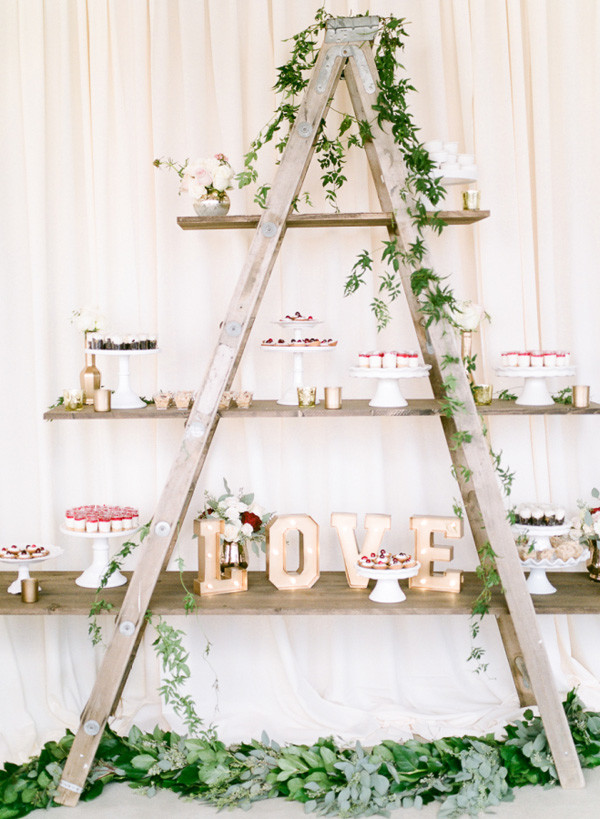 wedding food and drink stand with vintage ladder