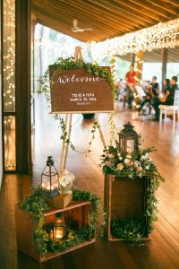 chic vintage wedding reception entrance ideas with lanterns and wooden