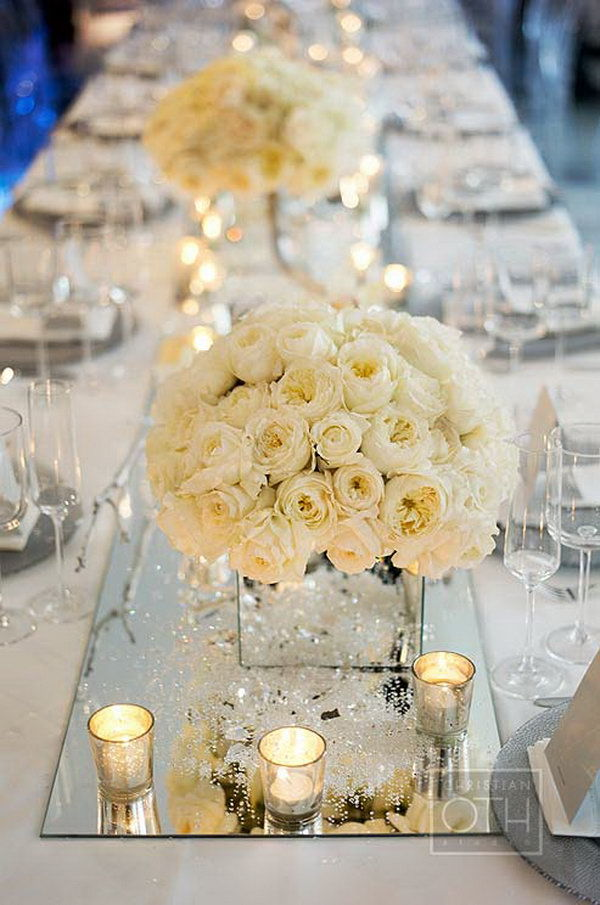 all white wedding centerpieces with candles and mirror