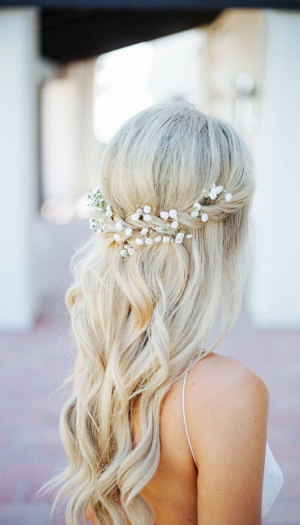 half up half down wedding hairstyle with baby breath