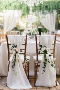 chiffon and floral wedding chair decoration ideas bride and groom