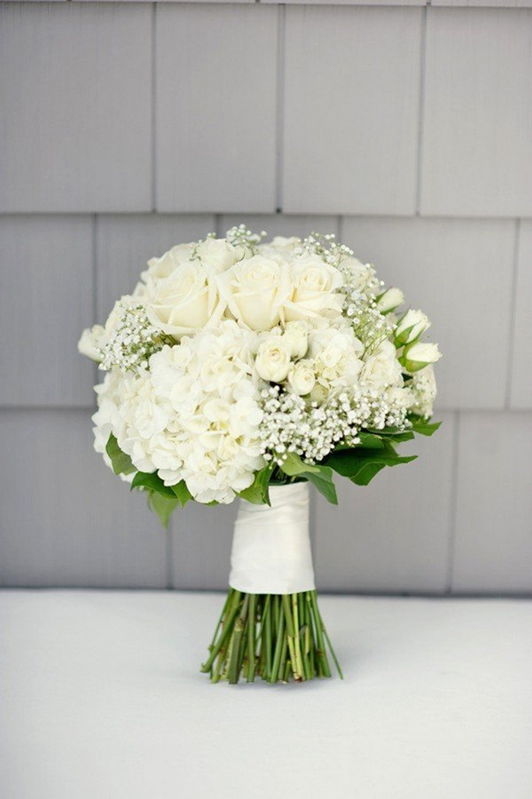 All White Wedding Bouquet With A Touch Of Greenery