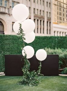 chic white and green wedding backdrop ideas with balloons