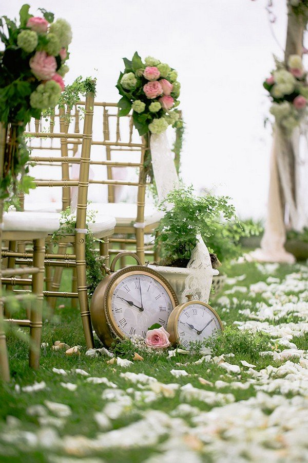 vintage wedding aisles decorated with clocks and floral