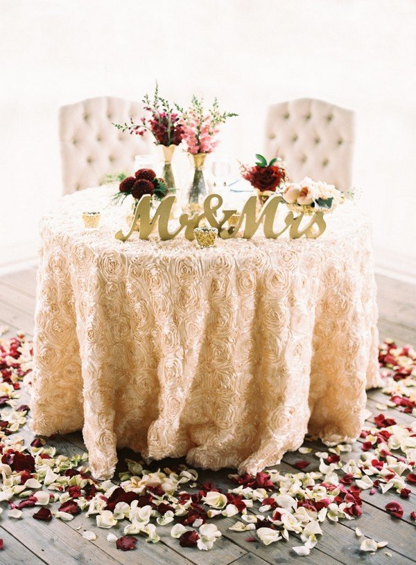 Petal accented wedding sweetheart table ideas