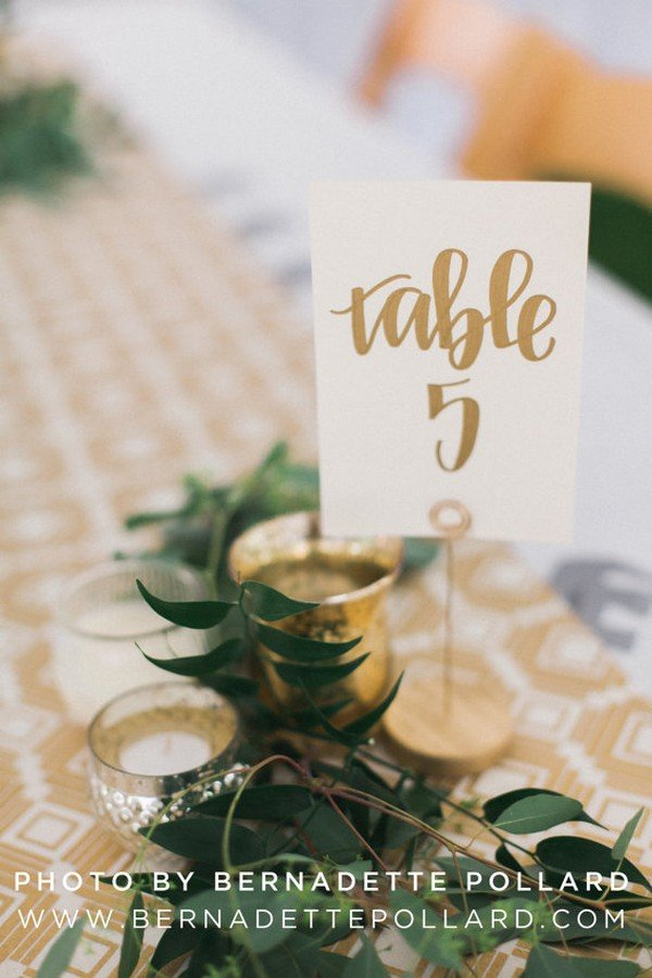 gold calligraphy wedding table numbers
