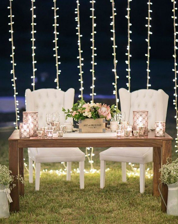 sweetheart wedding table decoration ideas with string lights backdrop