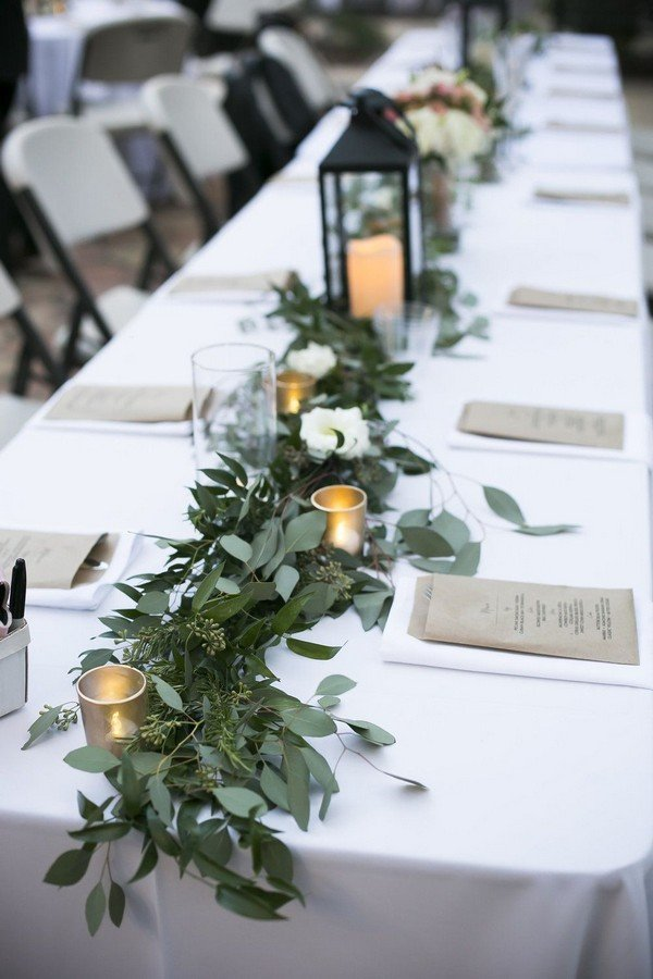 white and greenery wedding centerpieces with lanterns