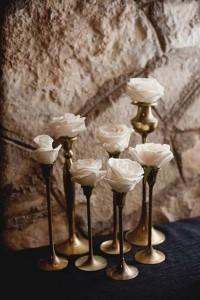 Flowers in candlesticks wedding centerpieces