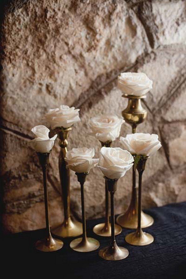 Flowers in candlesticks wedding centerpieces