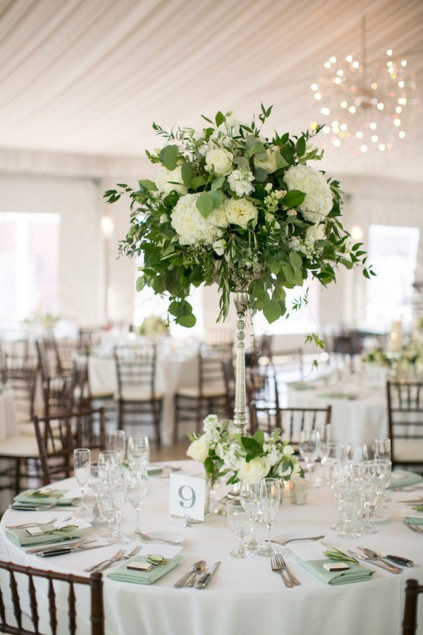 Green & white tall flower wedding centerpiece ideas with candlesticks