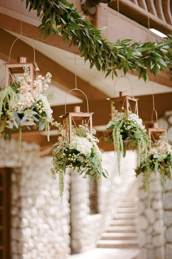 copper lanterns overflowing with a variety of greens wedding decoration ideas