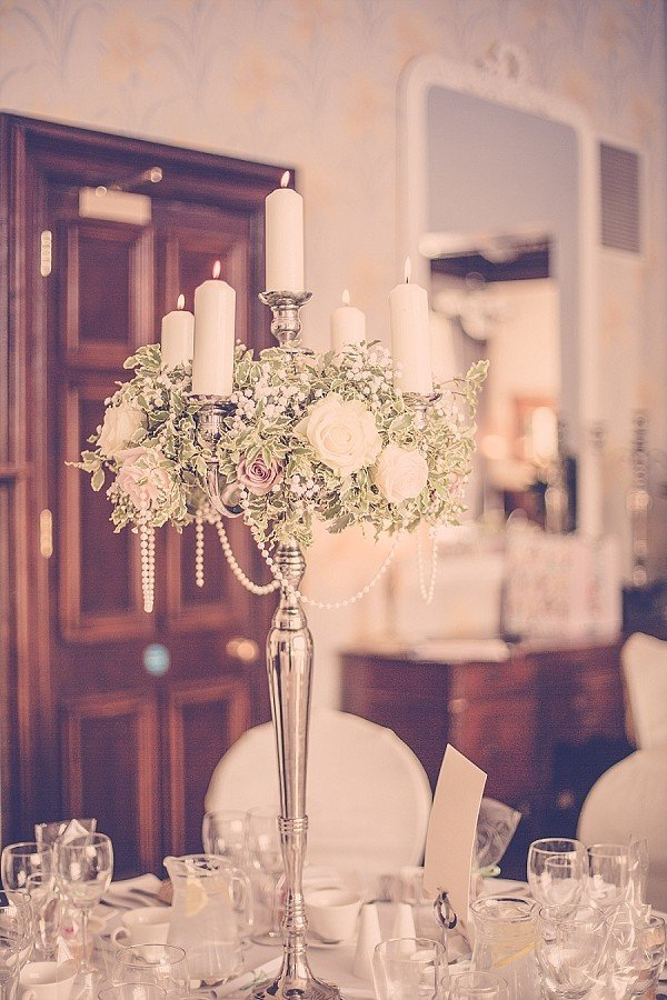 vintage glamour wedding centerpiece ideas with candlesticks and pearls
