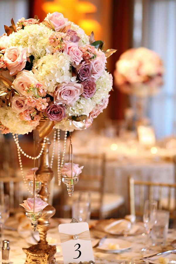 vintage wedding centerpieces ideas with flowers and candlestick
