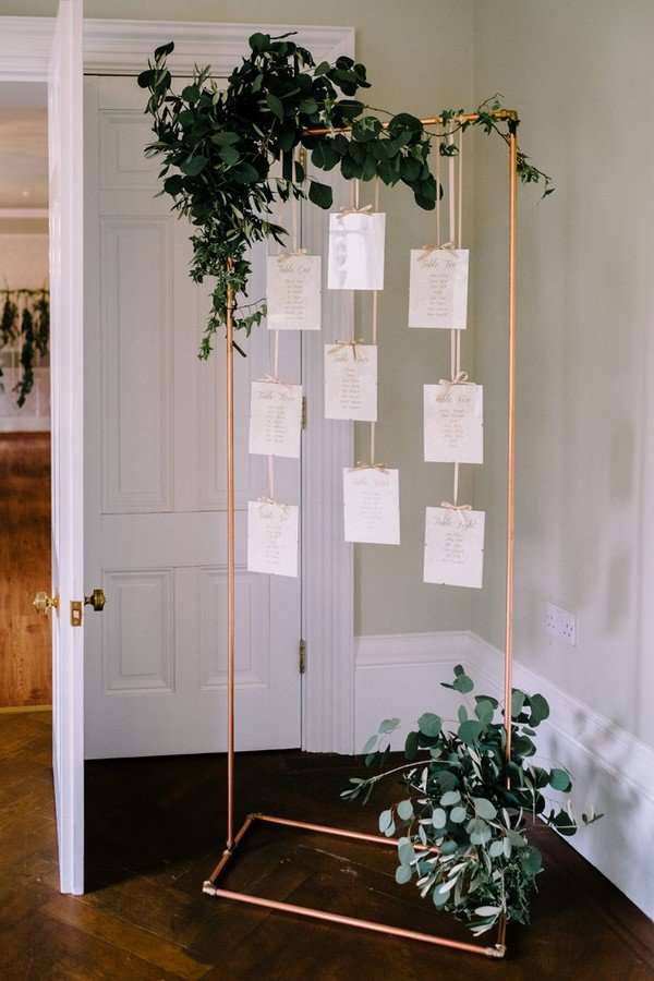 wedding seating plan display ideas with accents of copper